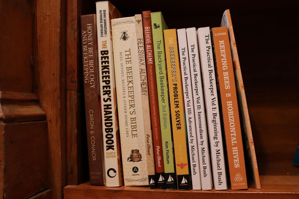 Beekeeping books on a shelf
